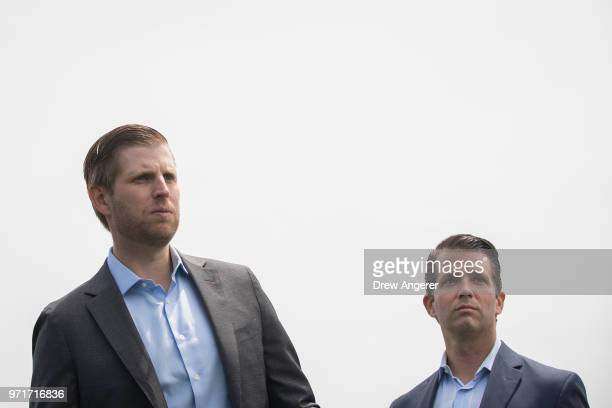 Eric Trump and Donald Trump Jr attend a ribbon cutting event for a new clubhouse at Trump Golf Links at Ferry Point June 11 2018 in The Bronx borough...