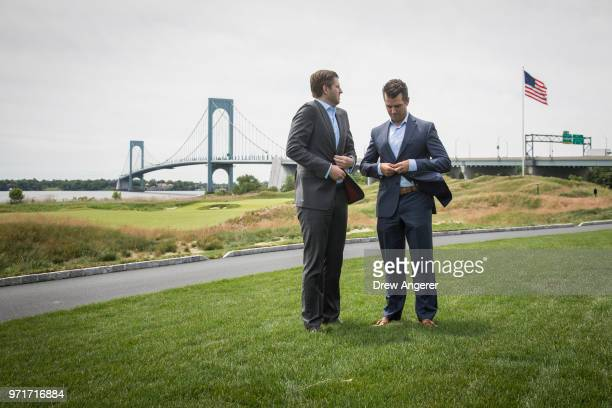Eric Trump and Donald Trump Jr. Prepare to pose for photos during a ribbon cutting event for a new clubhouse at Trump Golf Links at Ferry Point, June...