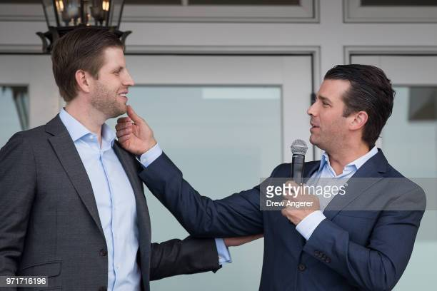Eric Trump and Donald Trump Jr who was making a joke about Eric not shaving today speak during a ribbon cutting event for a new clubhouse at Trump...