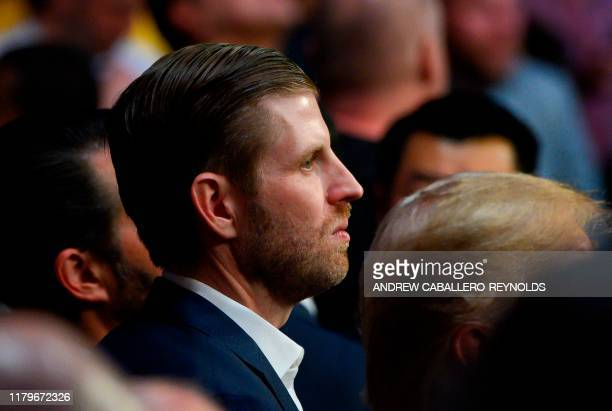 Eric Trump and his father US president Donald Trump watch the Ultimate Fighting Championship at Madison Square Garden in New York City New York on...