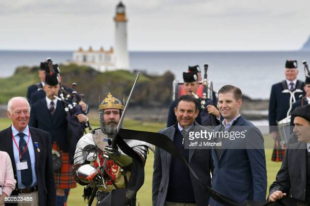 Eric Trump and his wife Lara attend the ceremonial ribbon cutting at Trump Turnberry's new golf course the King Robert The Bruce course on June 28...