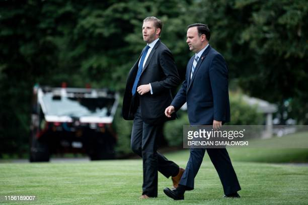 Eric Trump and White House Social Media Director Dan Scavino follow US President Donald Trump to Marine One on the South Lawn of the White House July...