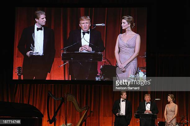 Eric Trump Donald Trump and Ivanka Trump speak during the attends European School Of Economics Foundation Vision And Reality Awards on December 5...