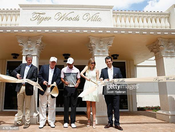 Eric Trump Donald Trump Tiger Woods Ivanka Trump and Donald Trump Jr cut a ribbon in front of the Tiger Woods Villa prior to the start of the World...