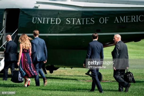 Eric Trump his wife Lara Yunaska Senior Advisor Jared Kushner and White House Chief of Staff John Kelly follow US President Donald Trump to Marine...