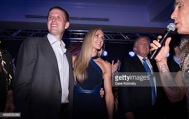 Eric Trump, Lara Yunaska and Donald Trump sing at The Eric Trump 8th Annual Golf Tournament at Trump National Golf Club Westchester on September 15,...