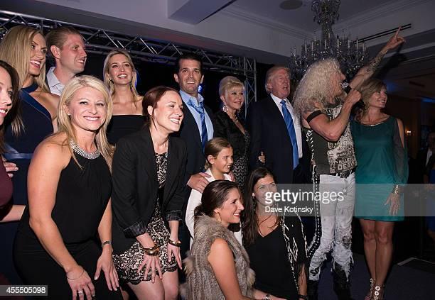 Eric Trump, Lara Yunaska, Ivanka Trump, Donald Trump, Dee Snider and Donald Trump Jr. Onstage during The Eric Trump 8th Annual Golf Tournament at...