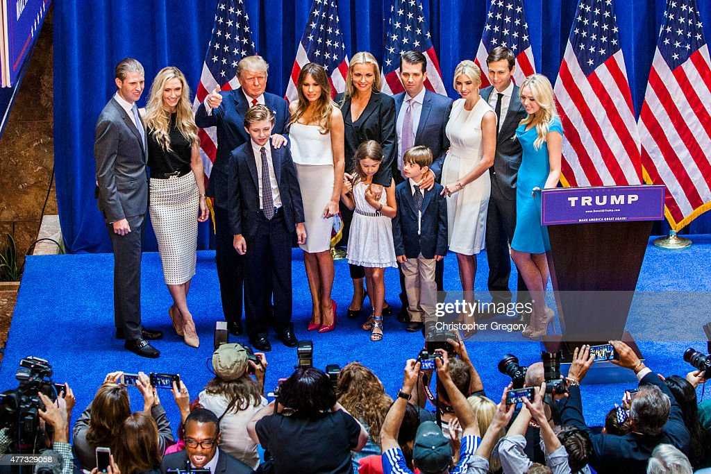 Eric Trump, Lara Yunaska Trump, Donald Trump, Barron Trump, Melania Trump, Vanessa Haydon Trump, Kai Madison Trump, Donald Trump Jr., Donald John Trump III, Ivanka Trump, Jared Kushner, and Tiffany Trump pose for photos on stage after Donald Trump announced his candidacy for the U.S. presidency at Trump Tower on June 16, 2015 in New York City. Trump is the 12th Republican who has announced running for the White House.