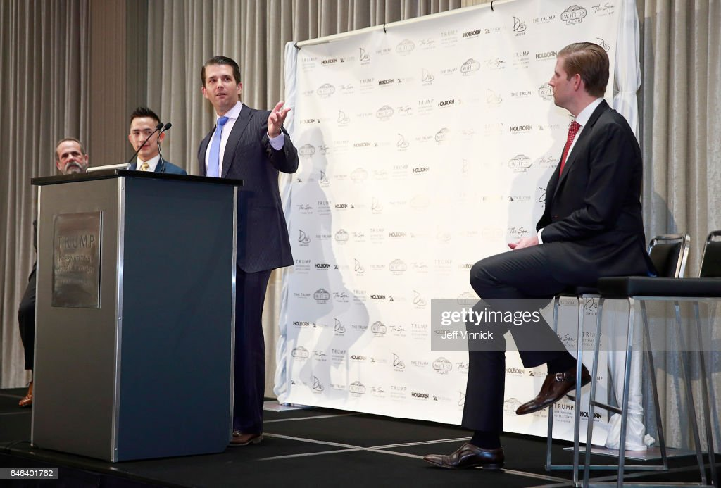 Eric Trump looks on as Donald Trump Jr. delivers a speech during a ceremony for the official opening of the Trump International Tower and Hotel on February 28, 2017 in Vancouver, Canada. The tower is the Trump Organization's first new international property since Donald Trump assumed the presidency.