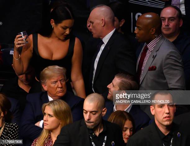 Eric Trump sits next to his father US president Donald Trump to watch the Ultimate Fighting Championship at Madison Square Garden in New York City...