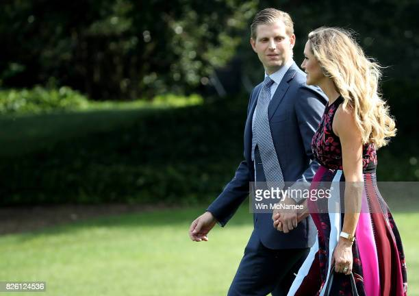 Eric Trump son of US President Donald Trump walks with his wife Lara to a waiting Marine One helicopter as his father departs the White House on his...
