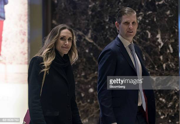 Eric Trump son of US Presidentelect Donald Trump and his wife Lara Yunaska Trump arrive in the lobby of Trump Tower in New York US on Friday Jan 13...