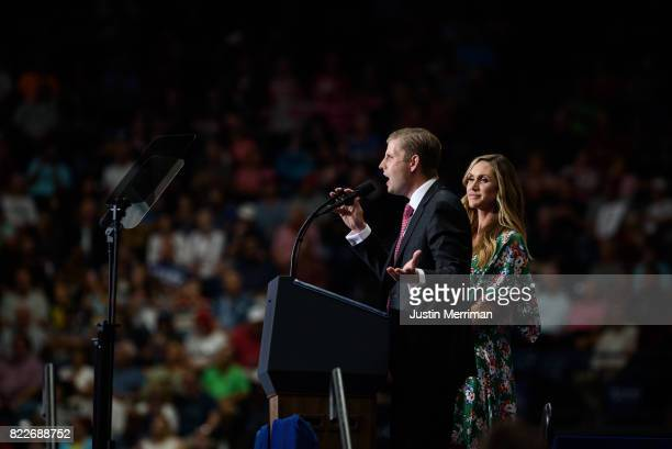 Eric Trump speaks as wife Lara Trump looks at a rally attended by US President Donald Trump at the Covelli Centre on July 25 2017 in Youngstown Ohio...