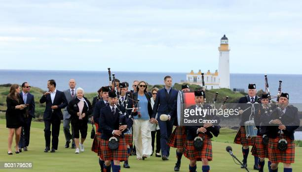 Eric Trump the EVP of the Trump Organisation his wife Lara and the official party are piped up the hill to officially open the course on the new 8th...
