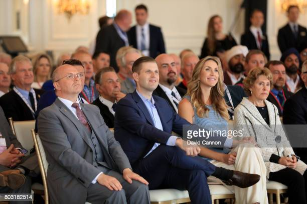 Eric Trump the EVP of the Trump Organisation his wife Lara to his side and Ralph Porciani the General Manager of Trump Turnberry listen to a speech...