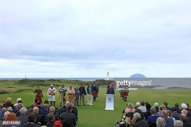 Eric Trump the EVP of the Trump Organisation speaks to the assembled guests and media on the new 8th green with the Turnberry Lighthouse and the...