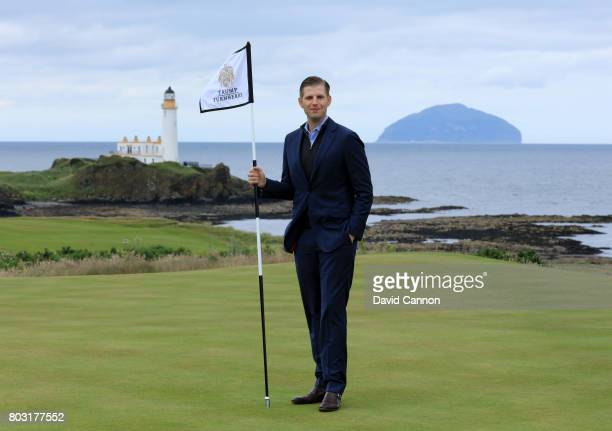 Eric Trump the EVP of the Trump Organisation stands on the new 8th green with the Turnberry Lighthouse and the island of Ailsa Craig in the distance...