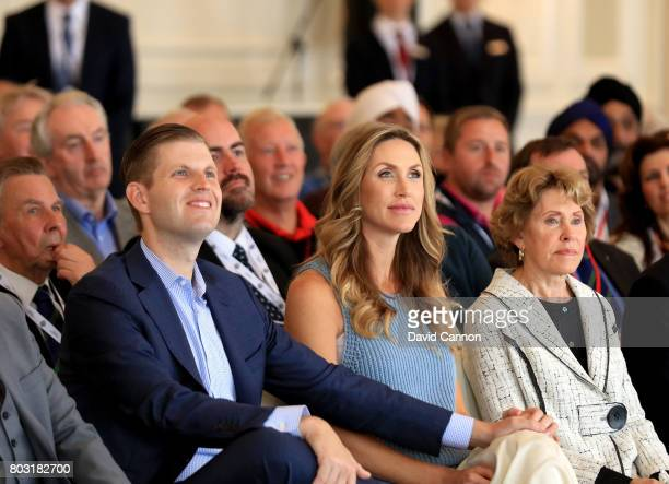 Eric Trump the EVP of the Trump Organisation with his wife Lara to his side listen to a speech in the Grand Ballroom during the official opening of...