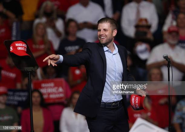 Eric Trump tosses a hat into the crowd at a campaign rally for his father US President Donald Trump at the BOK Center June 20 2020 in Tulsa Oklahoma...