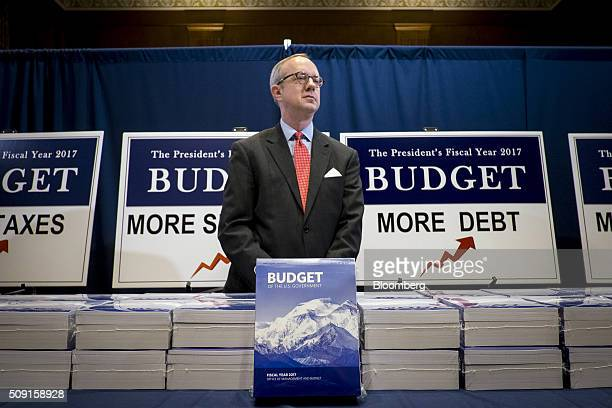 Eric Ueland a staff member with the Senate Budget Committee stands behind copies of US President Barack Obama's Fiscal Year 2017 Budget in Washington...