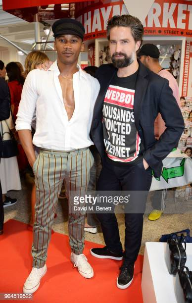 Eric Underwood and Jack Guinness attend Hello Magazine's 30th anniversary party at Dover Street Market on May 9 2018 in London England