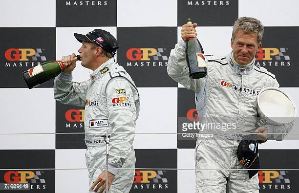 Eric van de Poele and Christian Danners celebrate on the podium after Eddie Cheever won the the GP Masters of Great Britain at Silverstone circuit on...