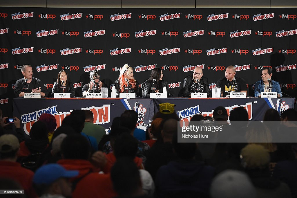 Eric Van Wagenen, Ivelisse, Rey Mysterio Jr, Taya, Catrina, Marty Elias, Skip Chaisson and Dorian Roldan speak onstage at Lucha Underground Panel at Javits center during 2016 New York Comic Con on October 9, 2016 in New York City.