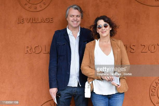 Eric Viellard and Isabelle Gelinas attend the 2019 French Tennis Open - Day Eight at Roland Garros on June 03, 2019 in Paris, France.