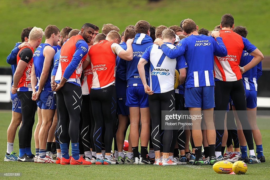 Eric Wallace listens to instructions with team-mates during a North Melbourne Kangaroos AFL media session at Arden Street Ground on July 16, 2014 in Melbourne, Australia.