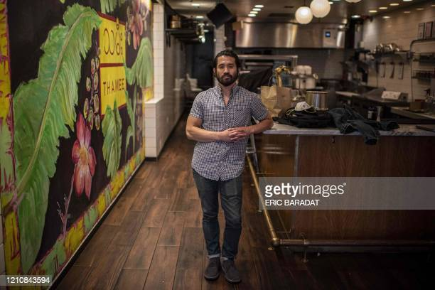 Eric Wang coowner of Burmese Restaurant Thamee on H street corridor poses during an interview about how small business owners are coping with the...