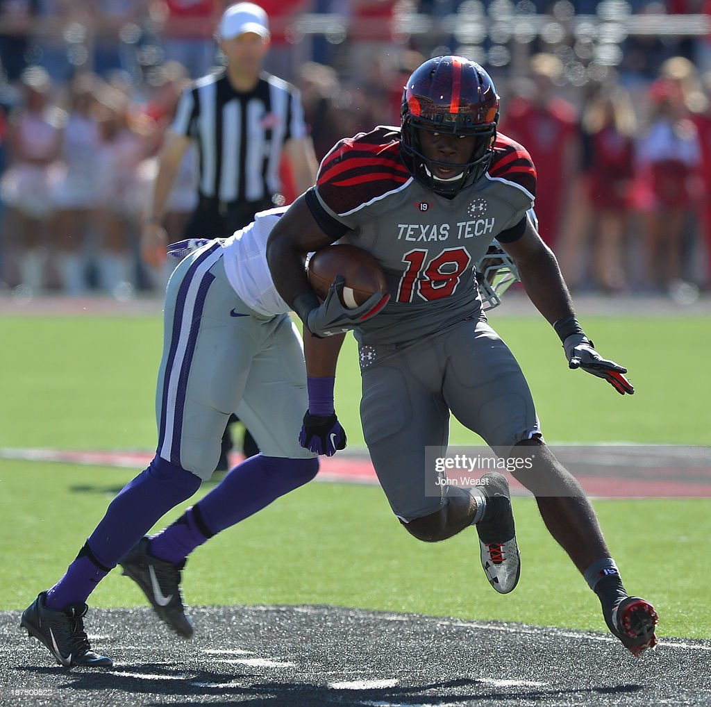 Eric Ward #18 of the Texas Tech Red Raiders gains yardage during game action against the Kansas State Wildcats on November 9, 2013 at AT&T Jones Stadium in Lubbock, Texas. The Kansas State Wildcats won the game 49-26.