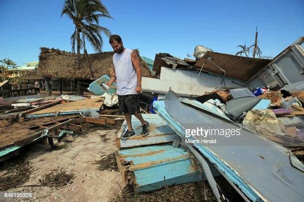 Eric Ward the bartender at Key Largo's Snappers inspects the damage from Hurricane Irma at the popular restaurant on Tuesday Sept 12 2017