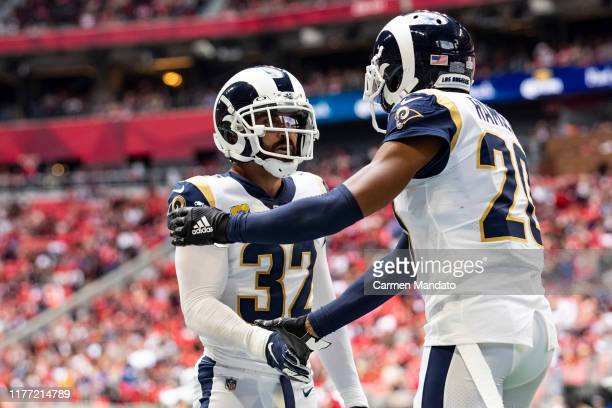 Eric Weddle and Jalen Ramsey of the Los Angeles Rams slap hands during the first half of a game against the Atlanta Falcons at Mercedes-Benz Stadium...