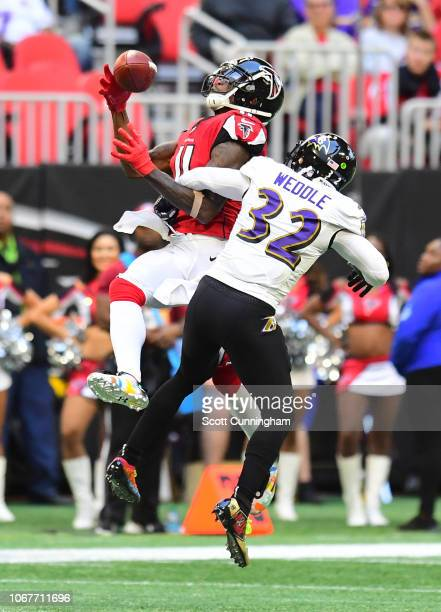 Eric Weddle of the Baltimore Ravens breaks up a pass intended for Julio Jones of the Atlanta Falcons at MercedesBenz Stadium on December 2 2018 in...