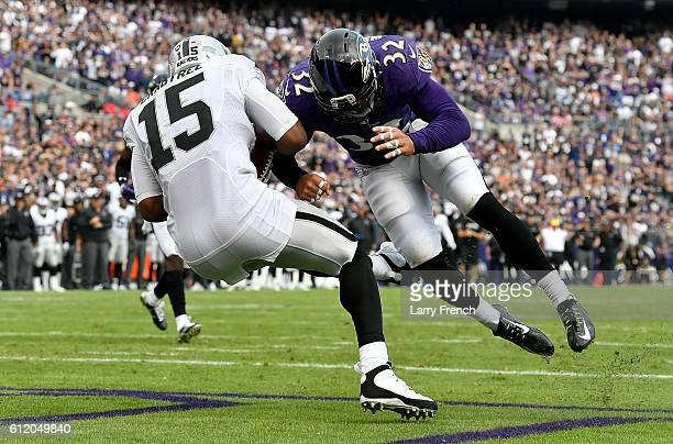 Eric Weddle of the Baltimore Ravens hits Michael Crabtree of the Oakland Raiders in the end zone in the fourth quarter at MT Bank Stadium on October...