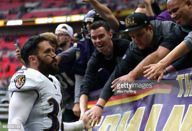 Eric Weddle of the Baltimore Ravens interacts with fans following the NFL International Series match between Baltimore Ravens and Jacksonville...