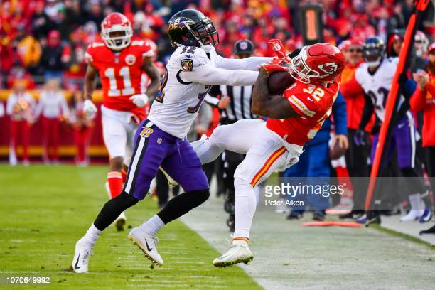 Eric Weddle of the Baltimore Ravens knocks Spencer Ware of the Kansas City Chiefs out of bounds during the second quarter of the game at Arrowhead...