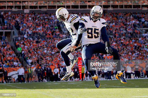 Eric Weddle of the San Diego Chargers celebrates his 23 yard interception for a touchdown with Shaun Phillips of the San Diego Chargers against the...