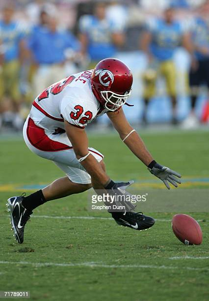 Eric Weddle of the Utah Utes dives for a loose ball against the UCLA Bruins during the college football game held on Septemeber 2, 2006 at the Rose...