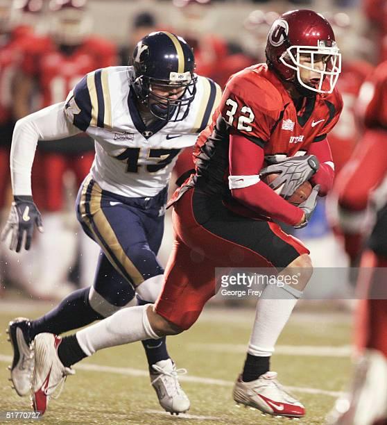 Eric Weddle of University of Utah pulls away from Kayle Buchanon of BYU November 20, 2004 at Rice Eccles Stadium in Salt Lake City, Utah.