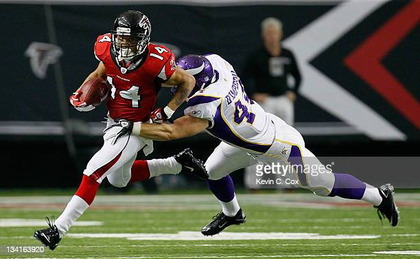 Eric Weems of the Atlanta Falcons returns a punt against Ryan D'Imperio of the Minnesota Vikings at Georgia Dome on November 27 2011 in Atlanta...