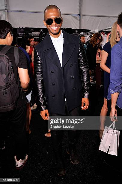 Eric West poses backstage at the Vivienne Tam fashion show during MercedesBenz Fashion Week Spring 2015 at The Theatre at Lincoln Center on September...