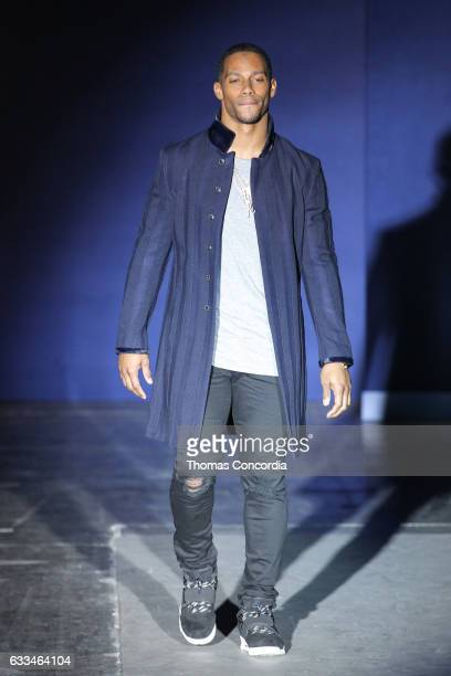 Eric West walks the runway during The Blue Jacket Fashion Show at NYFW Men's at Pier 59 on February 1 2017 in New York City
