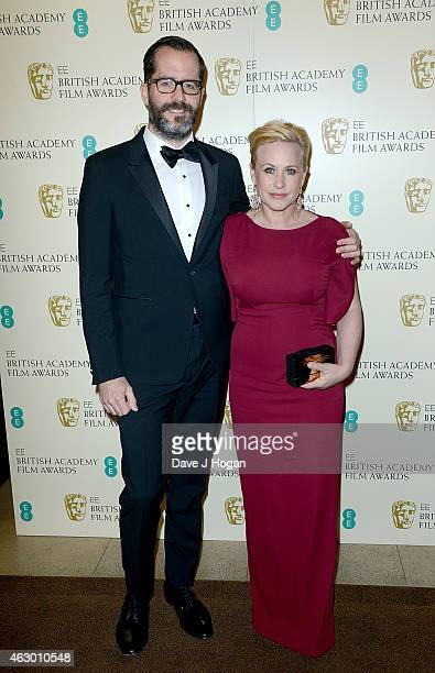 Eric White and Patricia Arquette attend the EE British Academy Film Awards at The Royal Opera House on February 8 2015 in London England