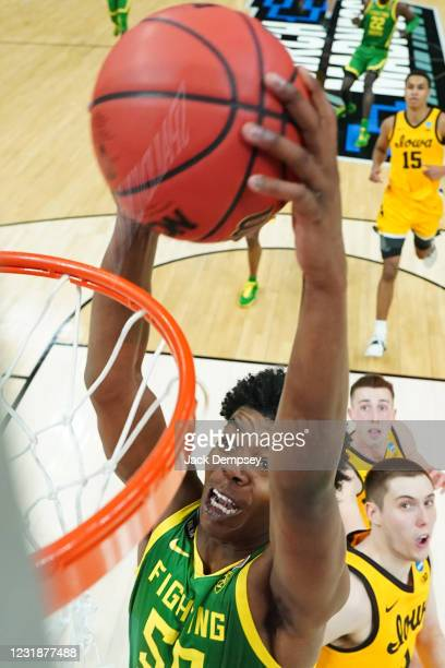 Eric Williams Jr. #50 of the Oregon Ducks dunks against CJ Fredrick of the Iowa Hawkeyes in the second round of the 2021 NCAA Division I Mens...