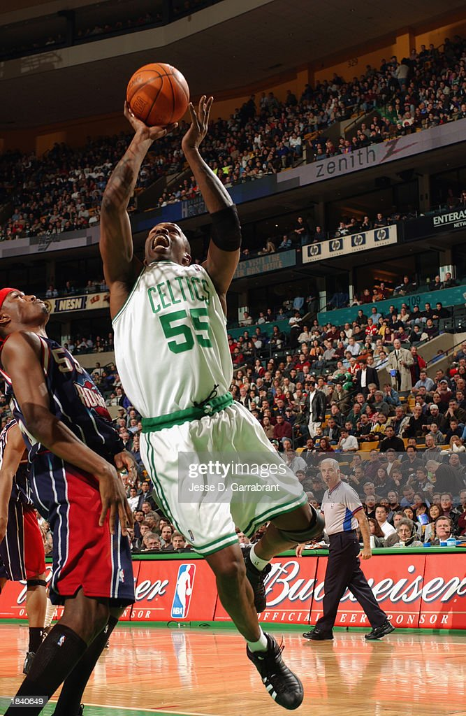 Eric Williams #55 of the Boston Celtics goes up for the shot during the NBA game against the Houston Rockets at Fleet Center on February 24, 2003 in Boston, Massachusetts. The Rockets won in overtime 101-95.