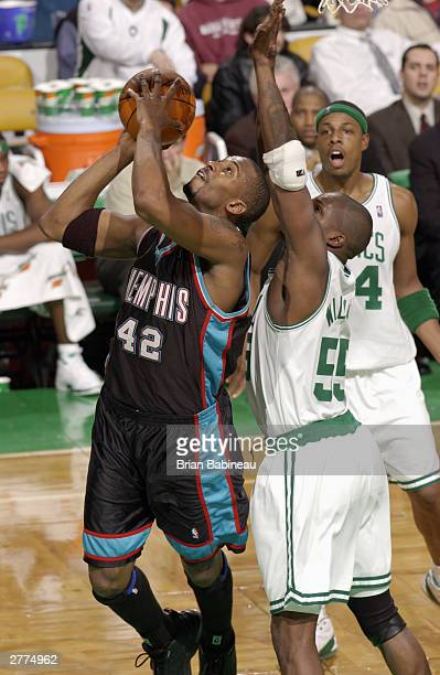 Eric Williams of the Boston Celtics tries to defend against Lorenzen Wright of the Memphis Grizzlies during the game at the Fleetcenter on December 1...