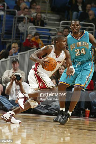 Eric Williams of the Cleveland Cavaliers looks for a lane against the New Orleans Hornets on February 23 2004 at Gund Arena in Cleveland Ohio NOTE TO...