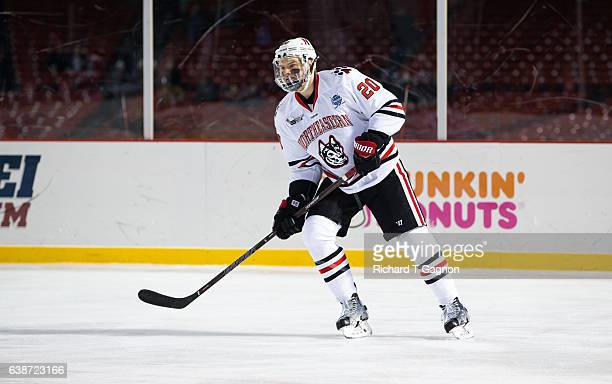 """Eric Williams of the Northeastern Huskies skates against the New Hampshire Wildcats during NCAA hockey at Fenway Park during """"Frozen Fenway"""" on..."""
