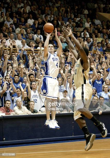 Eric Williams of the Wake Forest Demon Deacons tries to block a three pointer by JJ Redick of the Duke Blue Devils on February 20 2005 at Cameron...